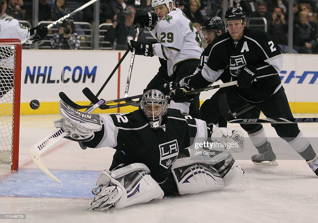 Goaltender Jonathan Quick #32 of the Los Angeles Kings lunges for the puck as Matt Greene #2 defends in the third period against the Dallas Stars at Staples Center on April 2, 2011 in Los Angeles, California. The Kings defeated the Dallas Stars 3-1.