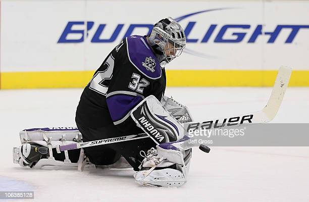 Goaltender Jonathan Quick of the Los Angeles Kings makes a save against the New Jersey Devils in the third period at Staples Center on October 30...