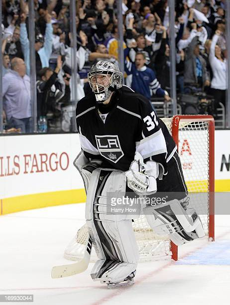 Goaltender Jonathan Quick of the Los Angeles Kings reacts after a goal by teammate Dwight King of the Los Angeles Kings in the third period of Game...
