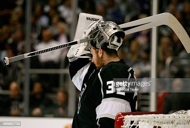 Goaltender Jonathan Quick of the Los Angeles Kings reacts after Benoit Pouliot of the New York Rangers scores in the first period of Game One of the...