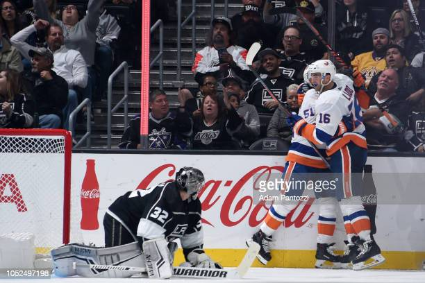 Goaltender Jonathan Quick of the Los Angeles Kings reacts as Valtteri Filppula and Andrew Ladd of the New York Islanders celebrates Filppula's...