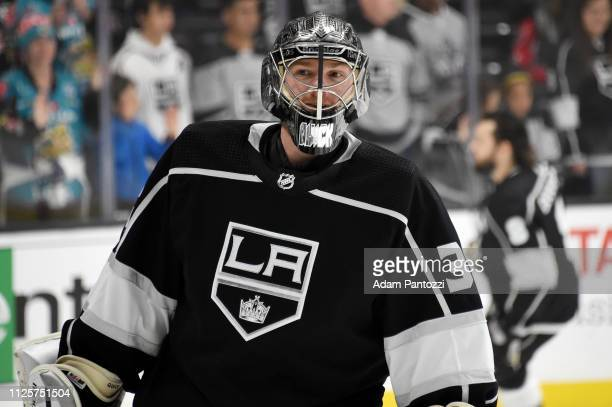 Goaltender Jonathan Quick of the Los Angeles Kings smiles while watching warm-up before the game against the Washington Capitals at STAPLES Center on...