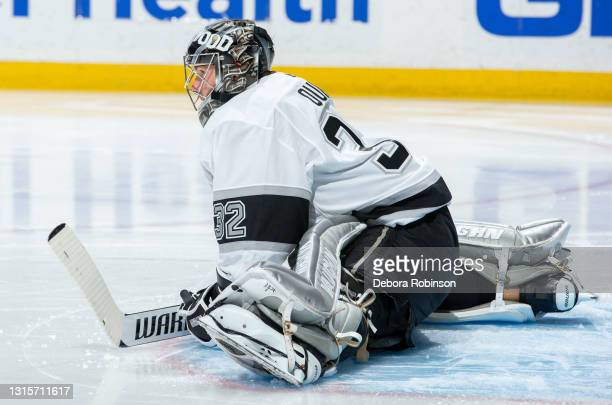 Goaltender Jonathan Quick of the Los Angeles Kings stretches on the ice before the second period of the game against the Anaheim Ducks at Honda...