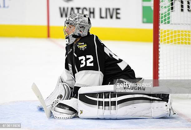 Goaltender Jonathan Quick of the Los Angeles Kings stretches on the ice during a preseason game against the Colorado Avalanche at TMobile Arena on...