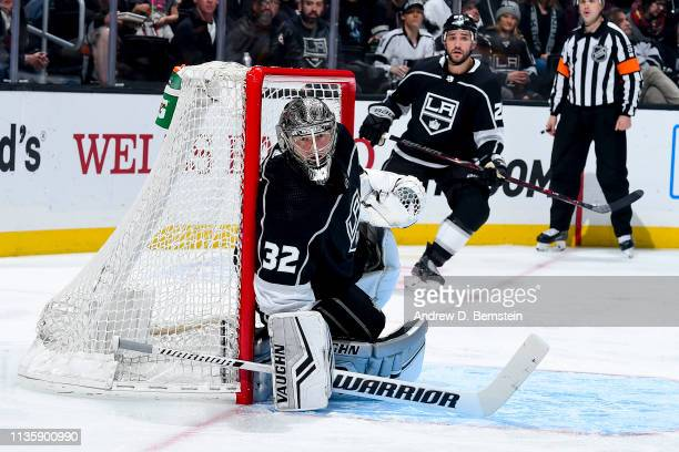Goaltender Jonathan Quick of the Los Angeles Kings tends net as Alec Martinez looks on during the second period of the game against the Nashville...