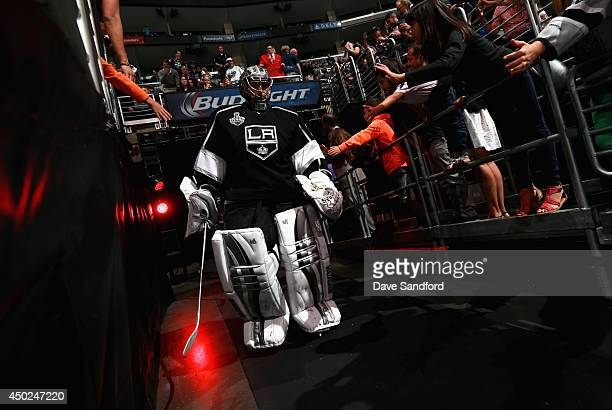 Goaltender Jonathan Quick of the Los Angeles Kings walks to the ice before the third period of Game Two of the 2014 Stanley Cup Final against the New...