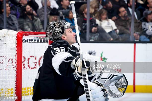 Goaltender Jonathan Quick of the Los Angeles Kings watches a replay on the scoreboard during the second period of the game against the New Jersey...