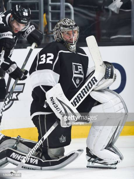 Goaltender Jonathan Quick of the Los Angeles Kings watches warm-up before the game against the Pittsburgh Penguins at STAPLES Center on February 26,...