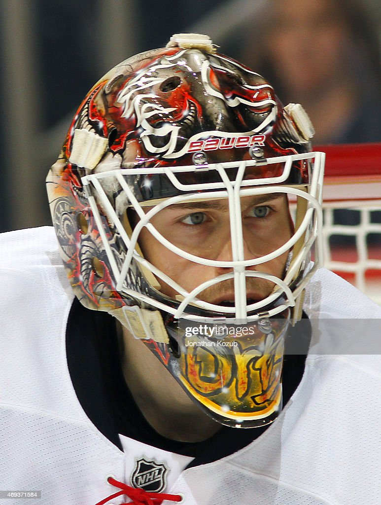 Goaltender Joni Ortio #37 of the Calgary Flames looks on during third period action against the Winnipeg Jets on April 11, 2015 at the MTS Centre in Winnipeg, Manitoba, Canada.
