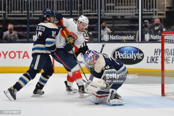 Goaltender Joonas Korpisalo of the Columbus Blue Jackets blocks a shot taken by Juho Lammikko of the Florida Panthers during the first period of a...