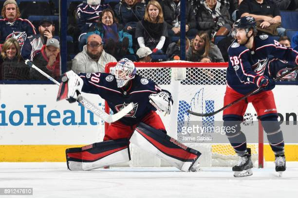 Goaltender Joonas Korpisalo of the Columbus Blue Jackets blocks a shot during the third period of a game against the Edmonton Oilers on December 12...