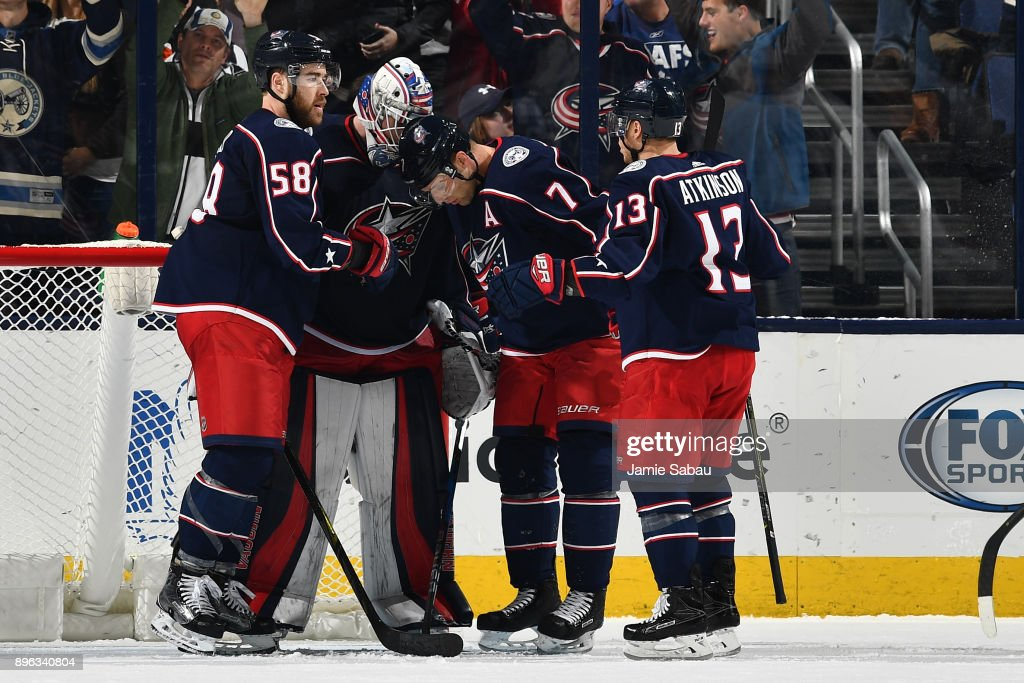 Goaltender Joonas Korpisalo #70 of the Columbus Blue Jackets celebrates his 4-2 victory over the Toronto Maple Leafs with teammates David Savard #58, Jack Johnson #7 and Cam Atkinson #13 of the Columbus Blue Jackets following a game on December 20, 2017 at Nationwide Arena in Columbus, Ohio.