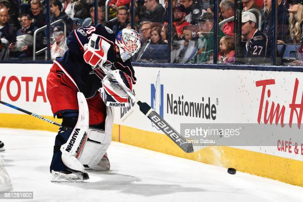 Goaltender Joonas Korpisalo of the Columbus Blue Jackets clears the puck during the second period of a game against the Carolina Hurricanes on...
