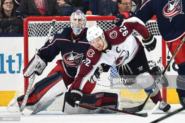 Goaltender Joonas Korpisalo of the Columbus Blue Jackets defends the net as Gabriel Landeskog of the Colorado Avalanche skates by on March 8 2018 at...