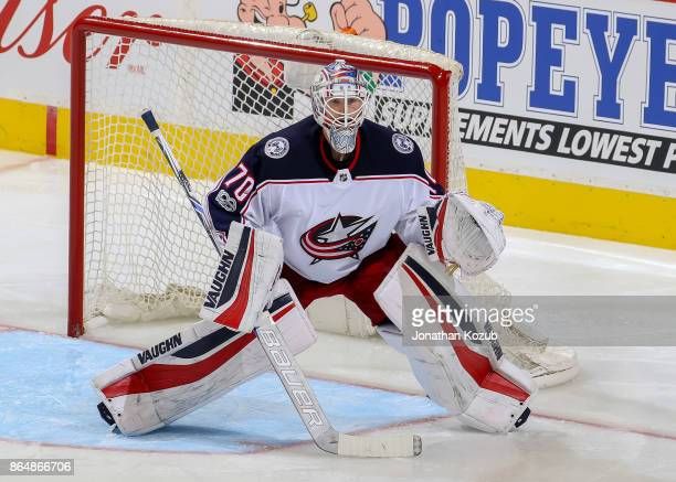 Goaltender Joonas Korpisalo of the Columbus Blue Jackets guards the net during second period action against the Winnipeg Jets at the Bell MTS Place...