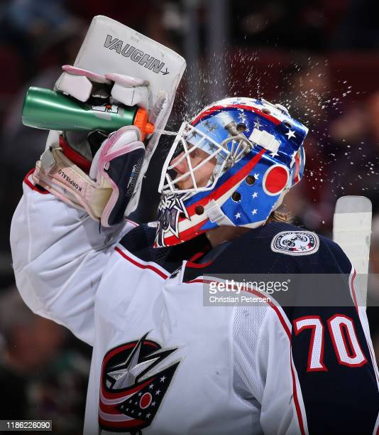 Goaltender Joonas Korpisalo of the Columbus Blue Jackets sprays water in his face during a break from the third period of the NHL game against the...