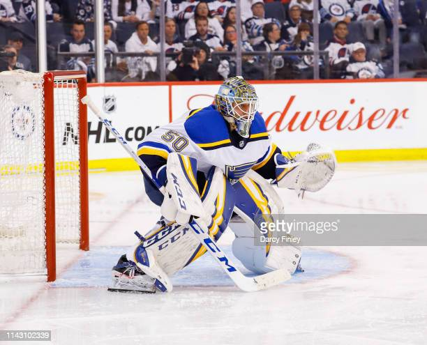 Goaltender Jordan Binnington of the St Louis Blues guards the net during second period action against the Winnipeg Jets in Game Two of the Western...