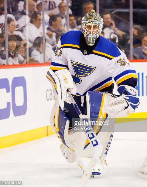 Goaltender Jordan Binnington of the St Louis Blues keeps an eye on the play during second period action against the Winnipeg Jets in Game Two of the...