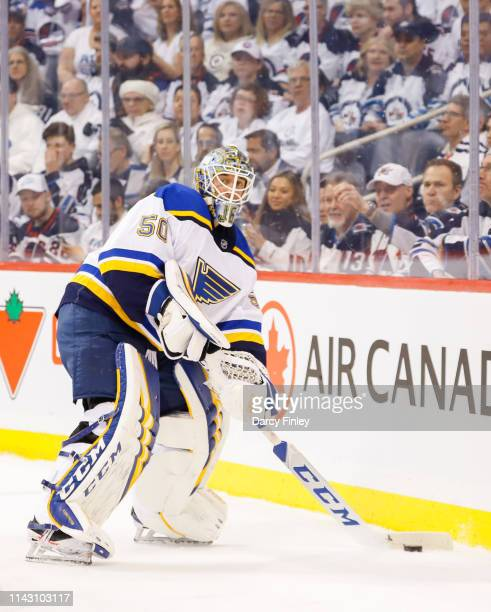 Goaltender Jordan Binnington of the St Louis Blues plays the puck behind the net during first period action against the Winnipeg Jets in Game Two of...