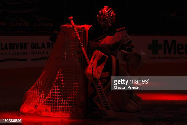 Goaltender Jordan Binnington of the St. Louis Blues warms up during player introductions to the NHL game against the Arizona Coyotes at Gila River...