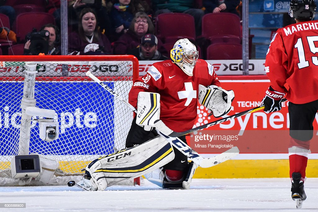 Goaltender Joren van Pottelberghe #30 of Team Switzerland allows a goal during the IIHF World Junior Championship preliminary round game against Team Czech Republic at the Bell Centre on December 27, 2016 in Montreal, Quebec, Canada. Team Switzerland defeated Team Czech Republic 4-3 in overtime.