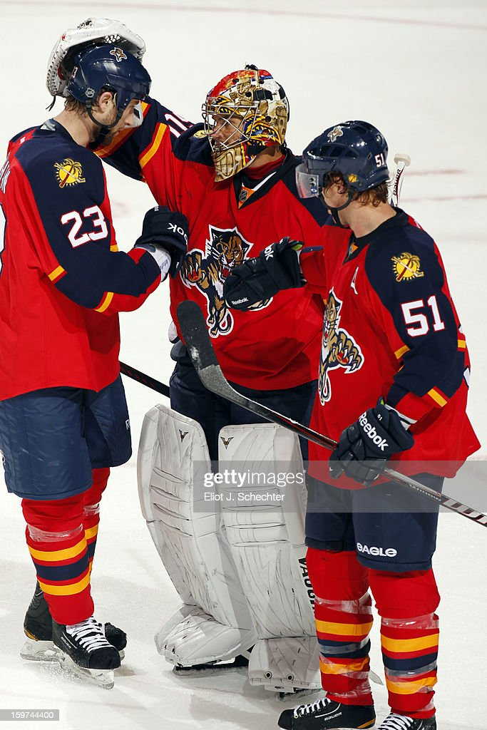 Goaltender Jose Theodore #60 of Florida Panthers celebrate their 5-1 win with teammates Tyson Strachan #23 and Brian Campbell #51 against the Carolina Hurricanes at the BB&T Center on January 19, 2013 in Sunrise, Florida.