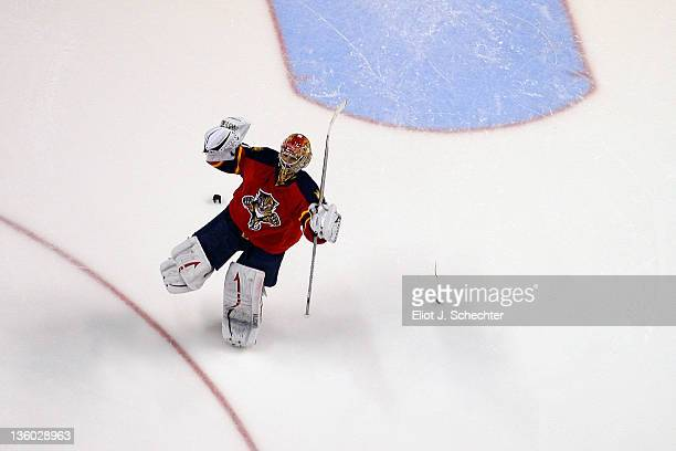 Goaltender Jose Theodore of the Florida Panthers celebrates their win against of the Calgary Flames at the BankAtlantic Center on December 16 2011 in...