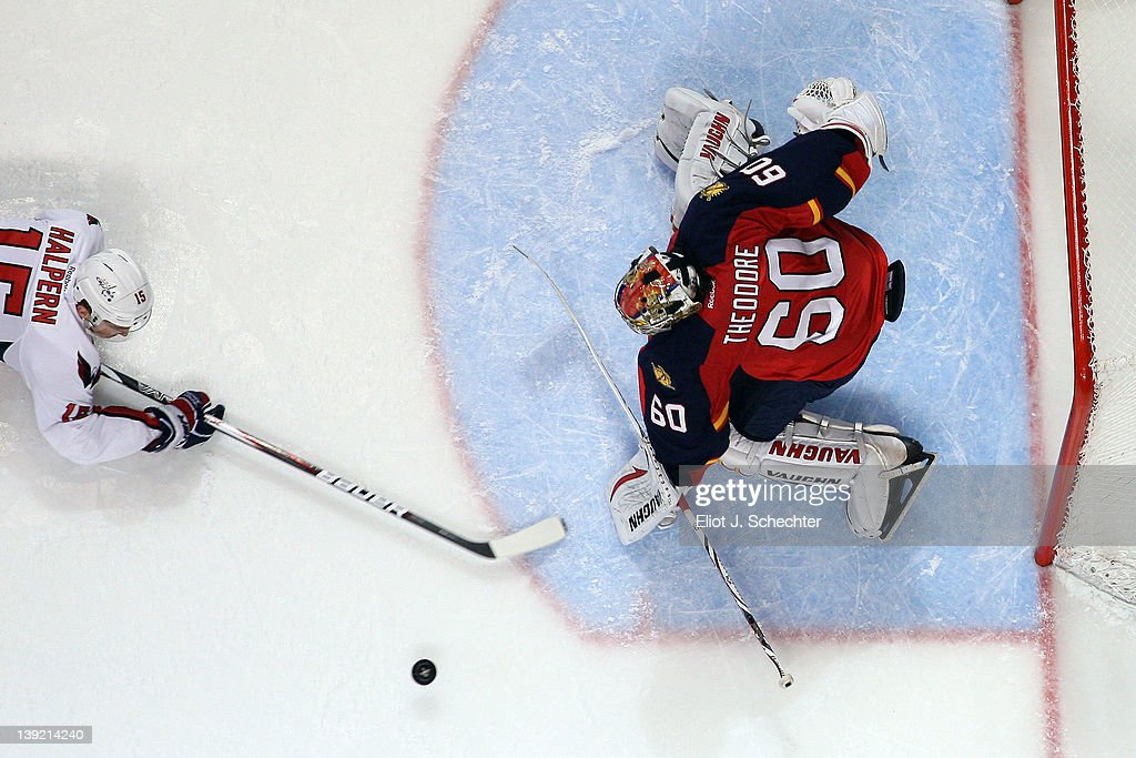 Goaltender Jose Theodore #60 of the Florida Panthers defends the net against Jeff Halpern #15 of the Washington Capitals at the BankAtlantic Center on February 17, 2012 in Sunrise, Florida.