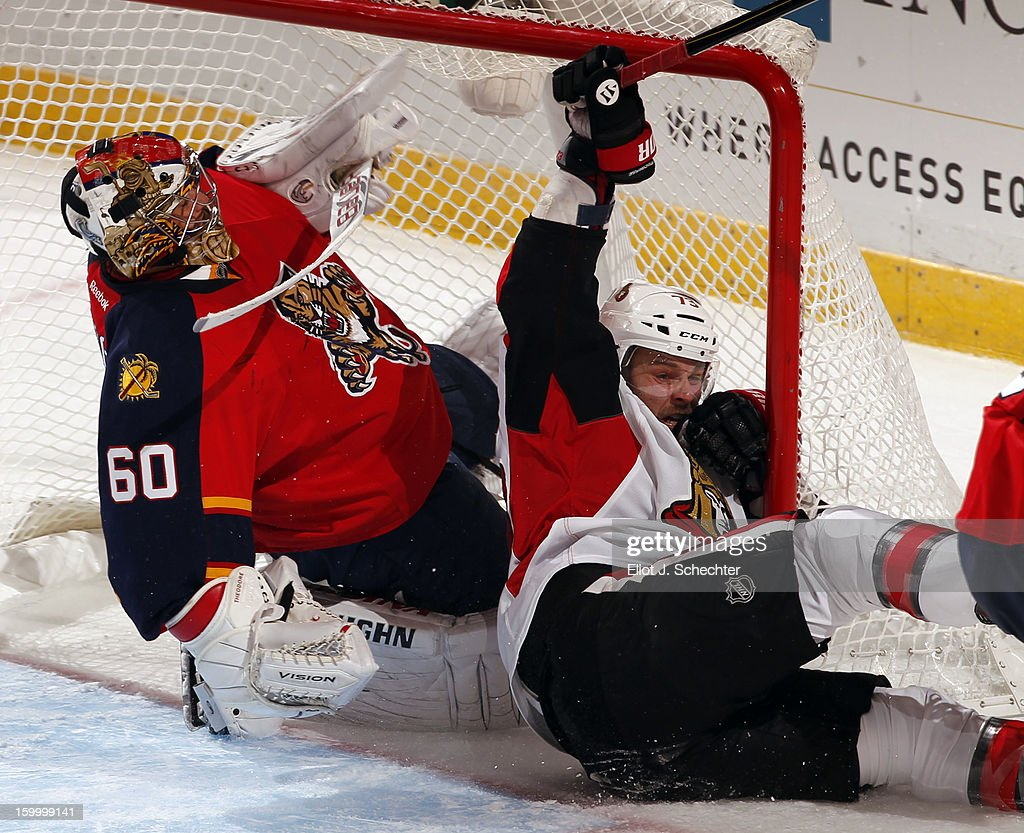 Goaltender Jose Theodore #60 of the Florida Panthers defends the net against Guillaume Latendresse #73 of the Ottawa Senators at the BB&T Center on January 24, 2013 in Sunrise, Florida.