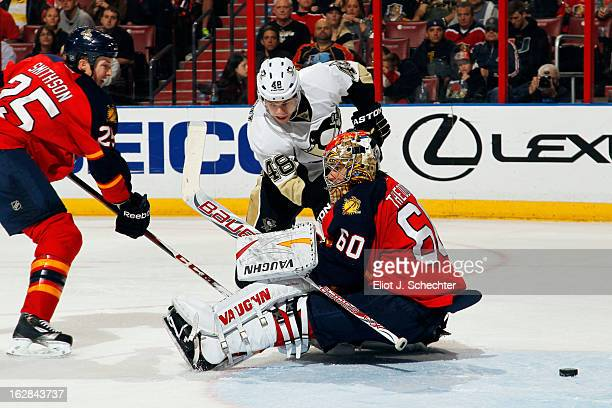 Goaltender Jose Theodore of the Florida Panthers defends the net with the help of teammate Jerred Smithson against Tyler Kennedy of the Pittsburgh...