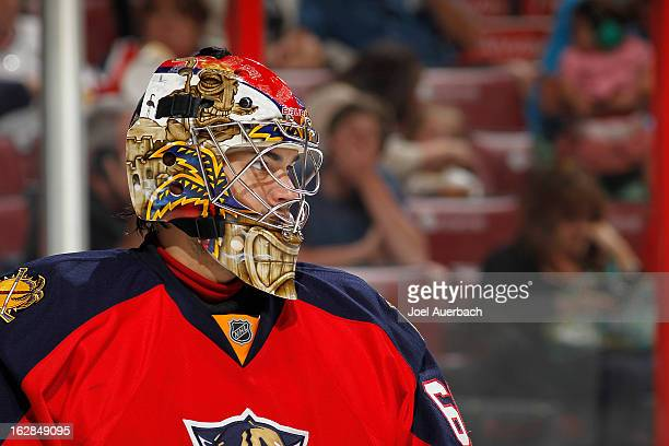 Goaltender Jose Theodore of the Florida Panthers looks up ice during second period action against the Pittsburgh Penguins at the BBT Center on...