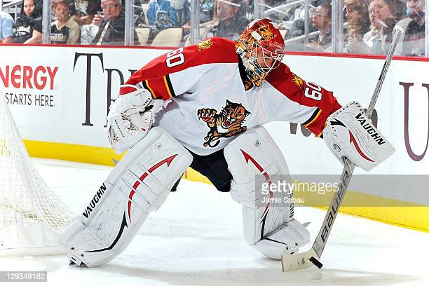 Goaltender Jose Theodore of the Florida Panthers plays the puck against the Pittsburgh Penguins on October 11 2011 at CONSOL Energy Center in...