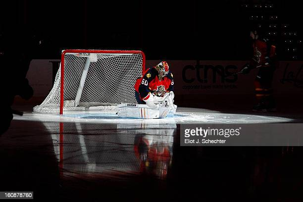Goaltender Jose Theodore of the Florida Panthers stretches on the ice prior to the start of the game against the Winnipeg Jets at the BBT Center on...