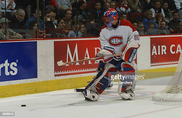 Goaltender Jose Theodore of the Montreal Canadiens clears the puck from behind the net against the Ottawa Senators during the game at Molson Centre...