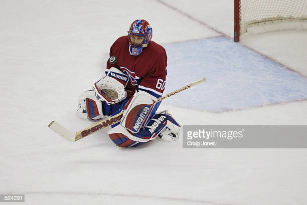 Goaltender Jose Theodore of the Montreal Canadiens goes down to make a save on the Carolina Hurricanes during game one of the Stanley Cup playoffs...
