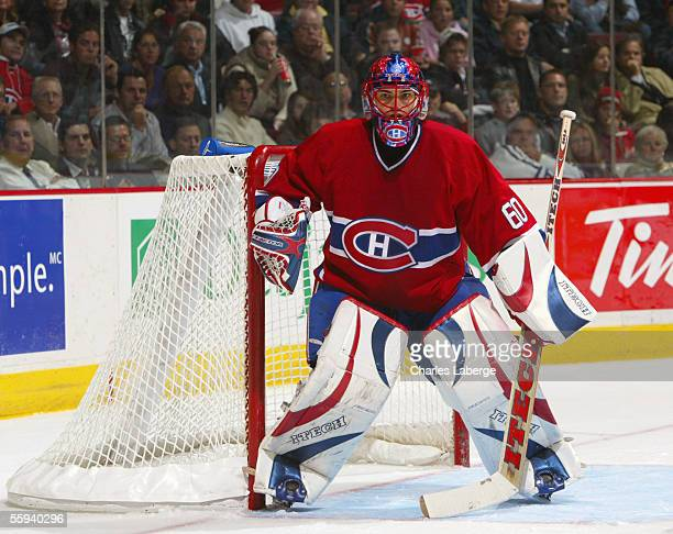 Goaltender Jose Theodore of the Montreal Canadiens guards the goal during the game against the Ottawa Senators during the Canadiens home opener at...