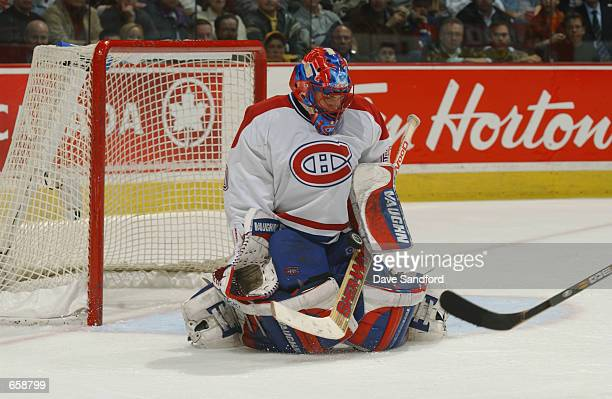 Goaltender Jose Theodore of the Montreal Canadiens makes a save on the Ottawa Senators during the game at Molson Centre in Montreal Quebec Canada on...