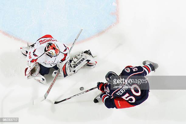 Goaltender Jose Theodore of the Washington Capitals stops a shot from Antoine Vermette of the Columbus Blue Jackets on April 3 2010 at Nationwide...