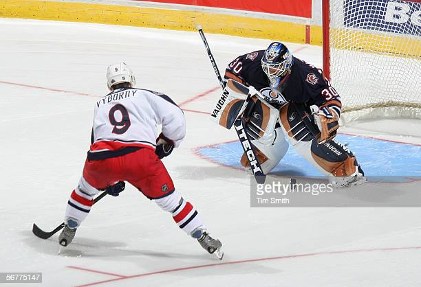 Goaltender Jussi Markanen of the Edmonton Oilers defends his net as David Vyborny of the Columbus Blue Jackets breaks in on goal during their game on...