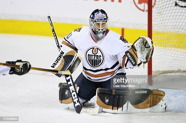 Goaltender Jussi Markkanen of the Edmonton Oilers guards the net against the Calgary Flames at the Pengrowth Saddledome on October 7, 2006 in...