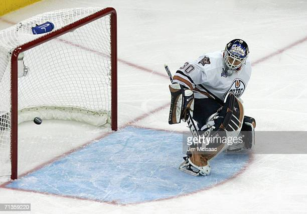 Goaltender Jussi Markkanen of the Edmonton Oilers makes a pad save against the Carolina Hurricanes during game five of the 2006 NHL Stanley Cup...
