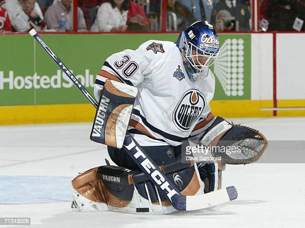 Goaltender Jussi Markkanen of the Edmonton Oilers makes a save on the shot from the Carolina Hurricanes during game seven of the 2006 NHL Stanley Cup...