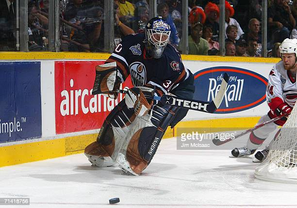 Goaltender Jussi Markkanen of the Edmonton Oilers moves the puck from behind the net against the Carolina Hurricanes during game three of the 2006...