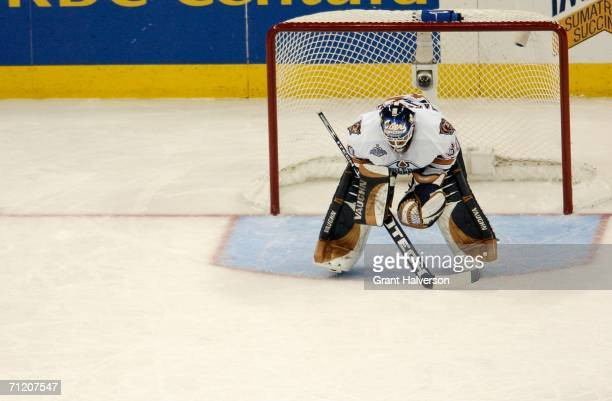 Goaltender Jussi Markkanen of the Edmonton Oilers reacts after giving up a goal in the second period of game five of the 2006 NHL Stanley Cup Finals...