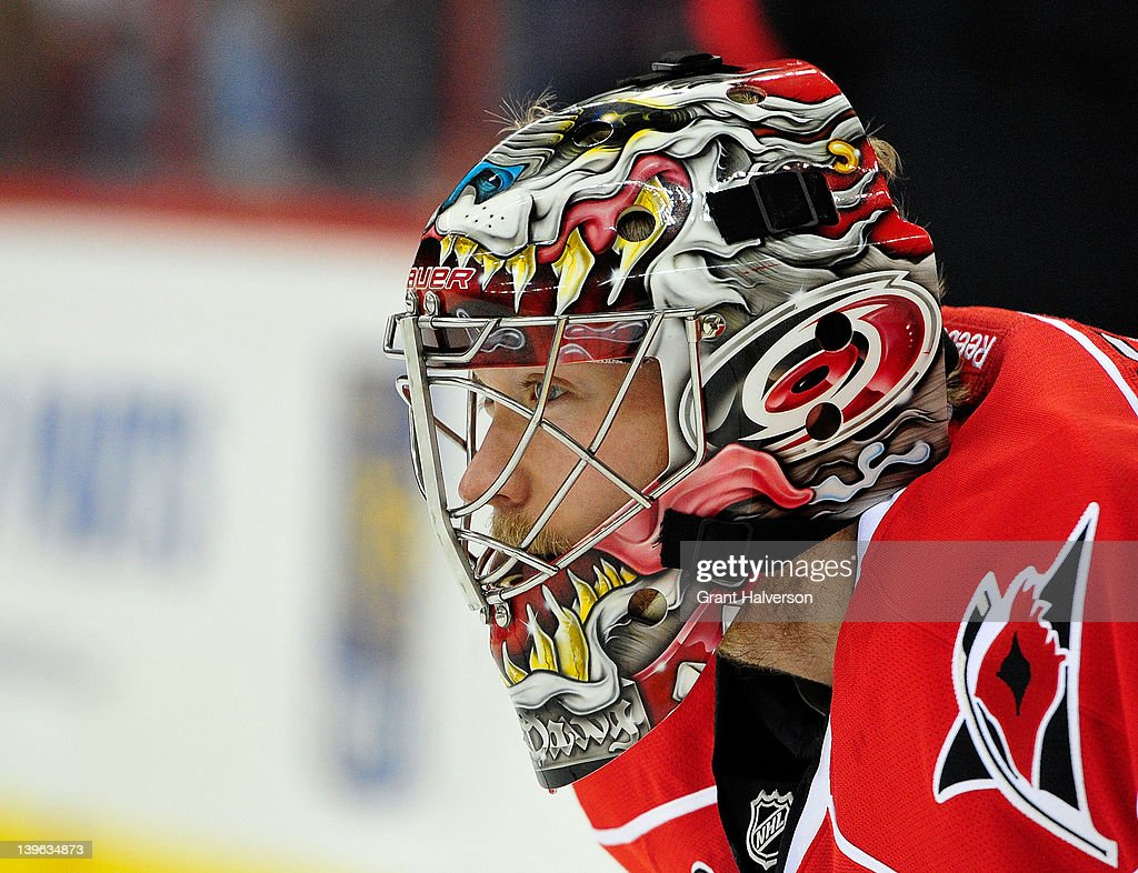 Goaltender Justin Peters #35 of the Carolina Hurricanes watches the action against the Anaheim Ducks at the RBC Center on February 23, 2012 in Raleigh, North Carolina.