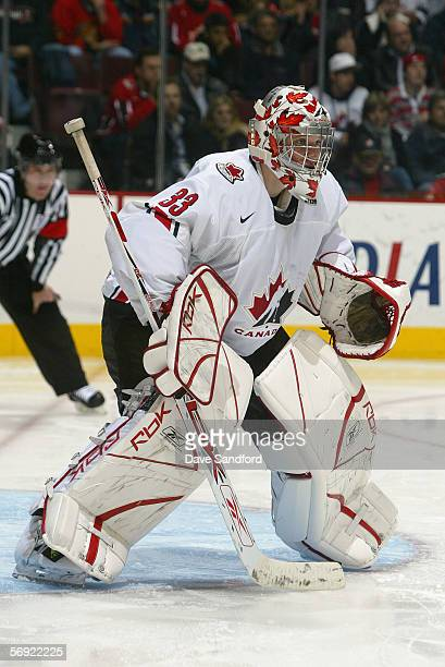 Goaltender Justin Pogge of Team Canada defends the net against Team Finland during their World Junior Hockey Championships semifinal game at General...