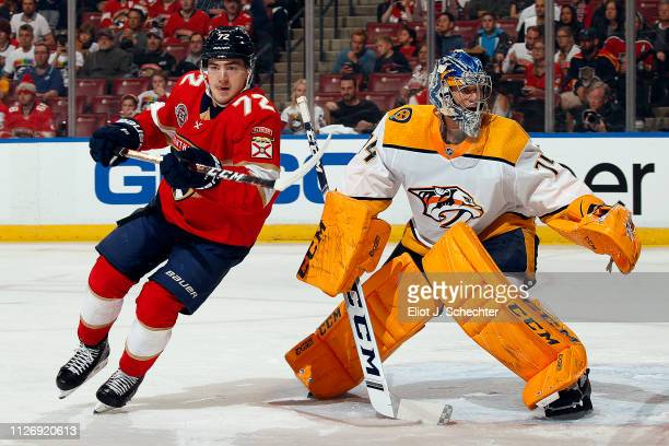 Goaltender Juuse Saros of the Nashville Predators defends the net against Frank Vatrano of the Florida Panthers at the BBT Center on February 1 2019...