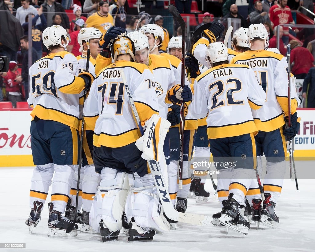 Goaltender Juuse Saros #74 of the Nashville Predators is congratulated by teammates after a win following an NHL game against the Detroit Red Wings at Little Caesars Arena on February 20, 2018 in Detroit, Michigan. The Predators defeated the Wings 3-2.
