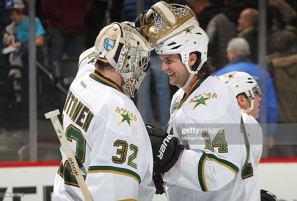 Goaltender Kari Lehtonen #32 and Jamie Benn #14 of the Dallas Stars celebrate the victory against the Colorado Avalanche at the Pepsi Center on February 4, 2013 in Denver, Colorado. The Stars defeated the Avalanche 3-2.