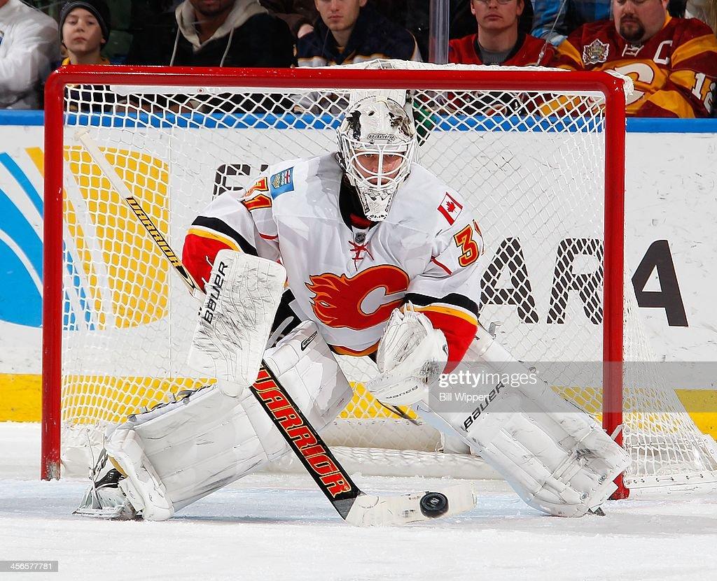 Goaltender Karri Ramo #31 of the Calgary Flames makes a save against the Buffalo Sabres on December 14, 2013 at the First Niagara Center in Buffalo, New York. Calgary won, 2-1.